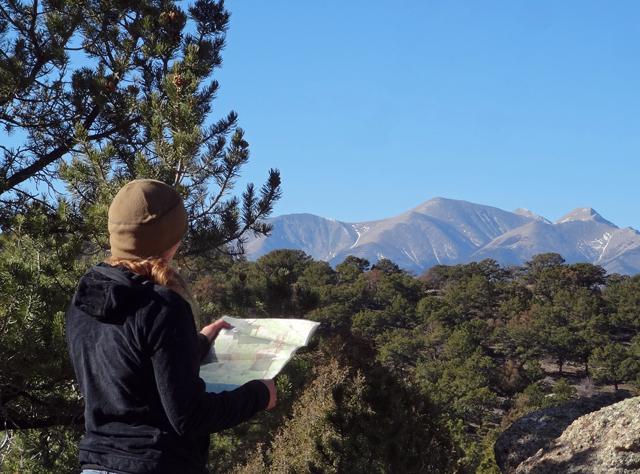 Woman-hiking-map small